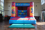 link to super hero indoor bouncy castle hire